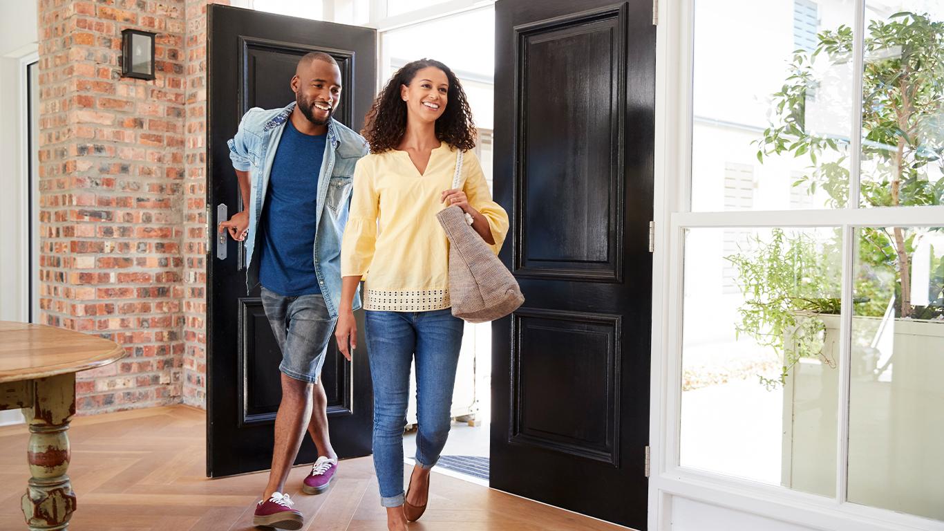 couple walking in through front door