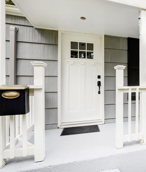 Custom fiberglass entry door painted white