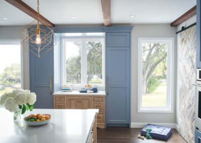 blue kitchen with large windows
